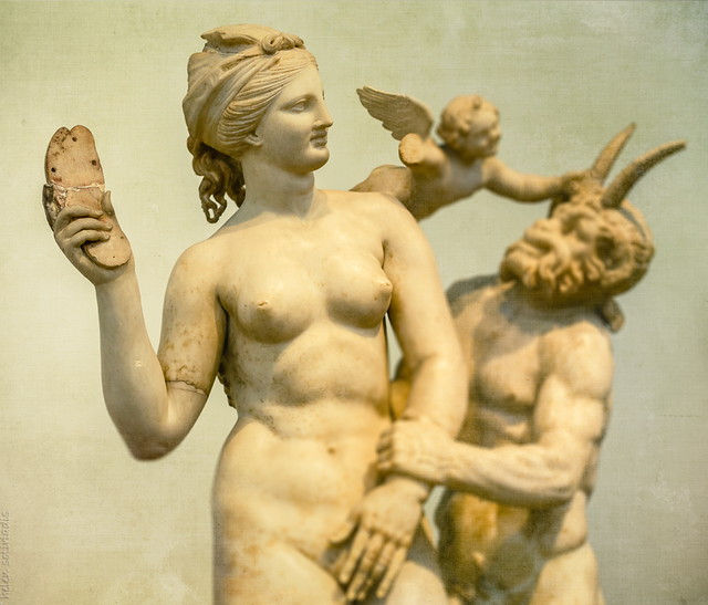 aphrodite fends off pan -- eros is amused