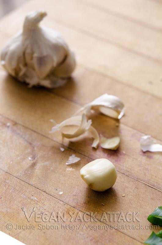 Garlic cloves on a cutting board