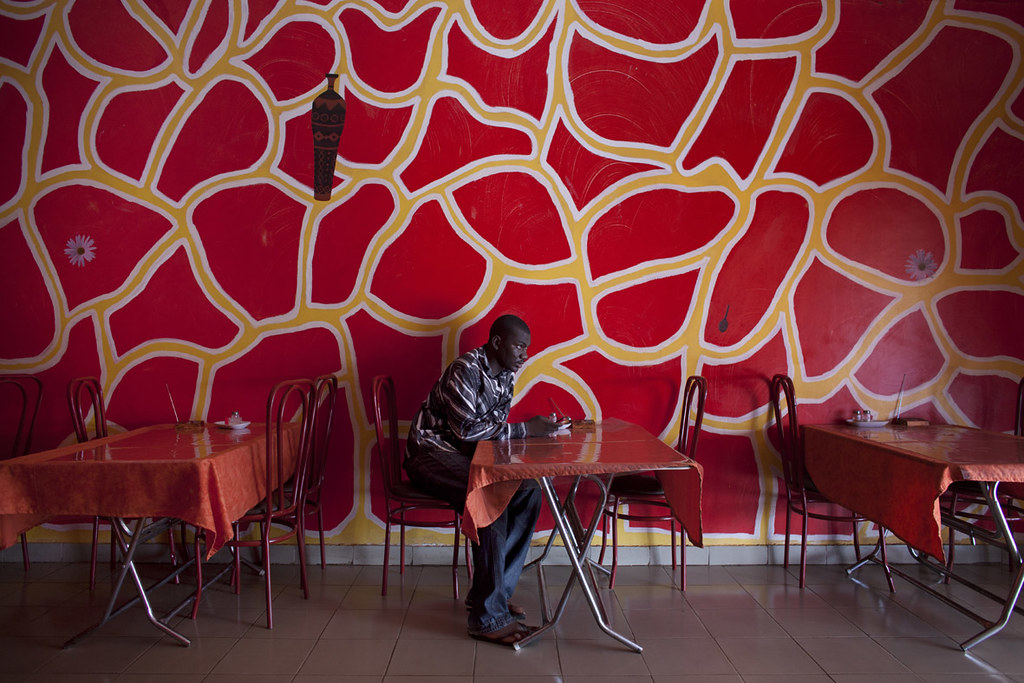Journalist Diouara sits in a restaurant in Bamako