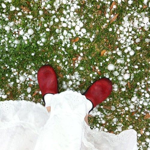 Red clogs and hail stones. #hail #extremeweather #lifeatwewillgo #redshoes #redandwhite #dansko