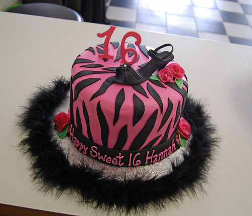 pink and black sweet 16 zebra cake with high heel shoe