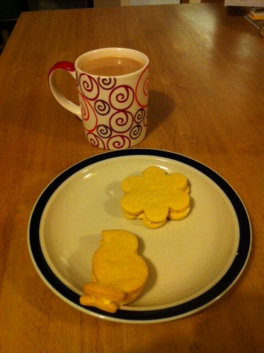 Eating these what I just baked. Custard creams in shapes of birds and flowers. by benparkuk