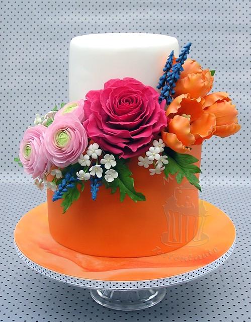 Orange cake with sugar flowers