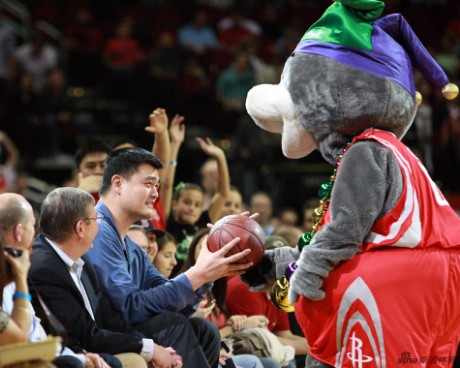 February 8th, 2013 - Yao Ming sits courtside at the Rockets-Trailblazers game in Houston