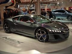 family car(0.0), automobile(1.0), automotive exterior(1.0), exhibition(1.0), wheel(1.0), vehicle(1.0), performance car(1.0), automotive design(1.0), auto show(1.0), honda nsx(1.0), land vehicle(1.0), luxury vehicle(1.0), supercar(1.0), sports car(1.0),