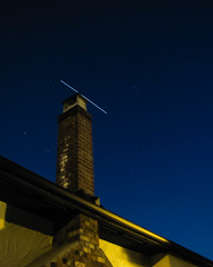 ISS zips by a chimney