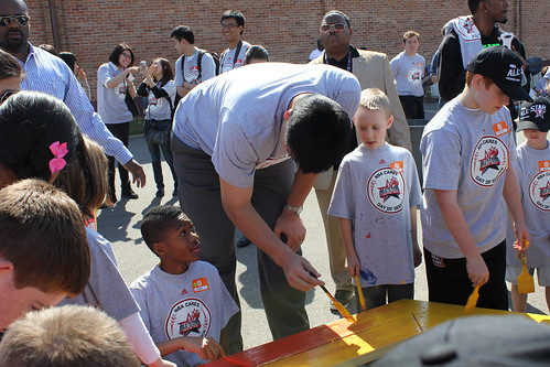 February 15th, 2013 - Yao Ming paints a bench at the NBA Day of Service in Houston
