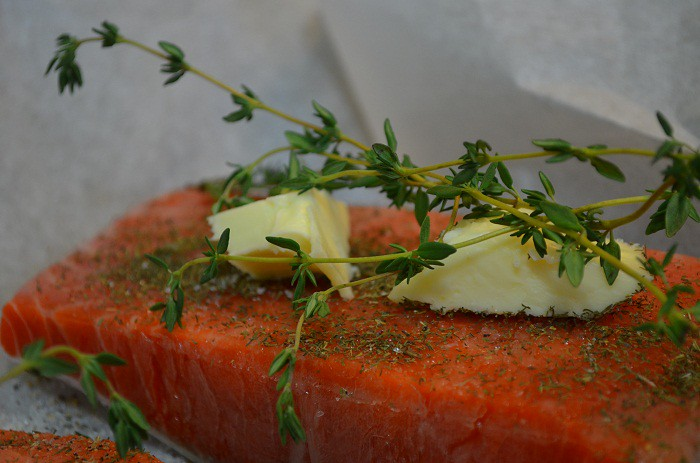Add butter and thyme to salmon | My Halal Kitchen