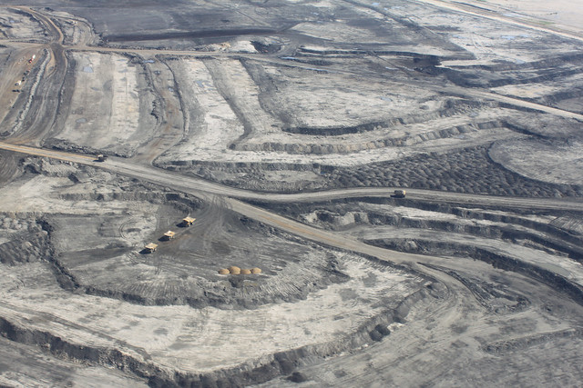 Trucks in an open pit mine in Canada's oil sands