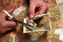 Igor Arinich cutting banknote