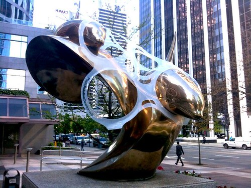 Giant plastic six-pack rings strangle public sculptures
