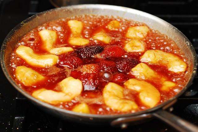 Apple tarte tatin, or caramel apple tart, with strawberries
