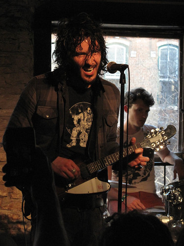 Reignwolf on mandolin at Peckerhead's