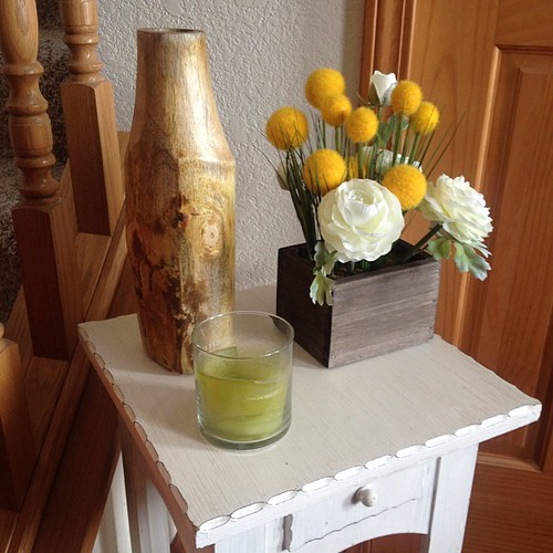 I spruced up the little table in my foyer with this wooden vase and fake floral arrangement.  #target