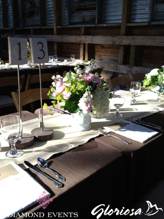 Rustic table numbers on pedestal stands