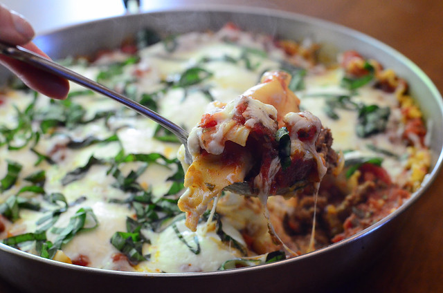A spoon scoops out some Skillet Lasagna.