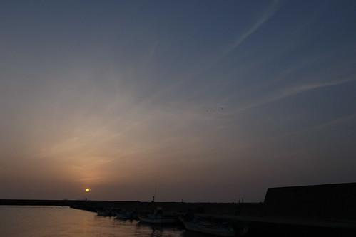 太陽と釣り人と鳥たち