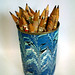 marbled tin can with pencil