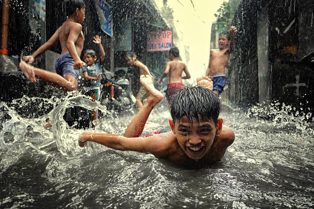 Fun in Monsoon rain and flood