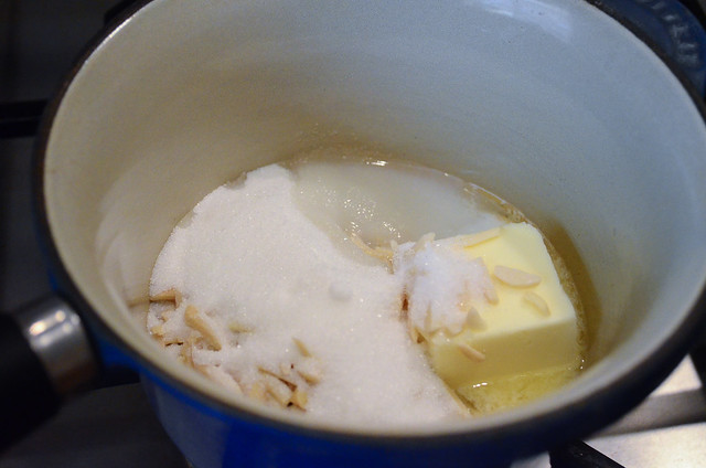 Butter, Almonds, sugar, and milk in a pan.