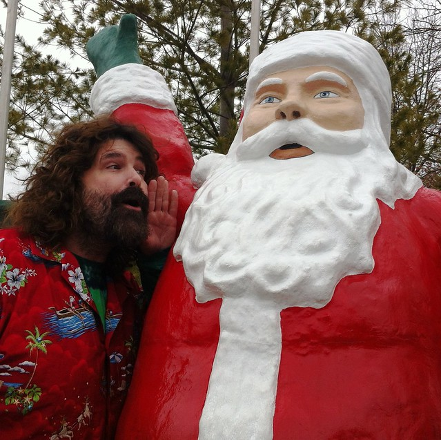 Mick Foley whispers in Santa's ear