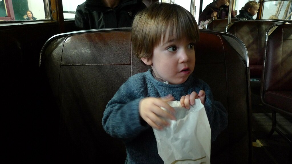 Jasper Eating Sweets On The Old Bus
