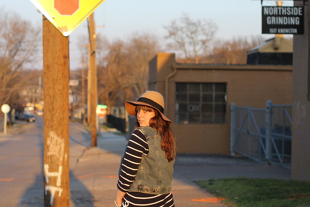 Spring Sunset outfit: striped mariner anchor dress from J.Crew, altered vintage denim vest, brown boots, skinny jeans, wide-brimmed wool hat - Anthropologie