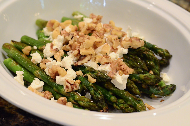 Toasted walnuts are added to the asparagus.