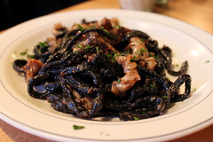Squid ink black pasta and calamari. A signature dish.