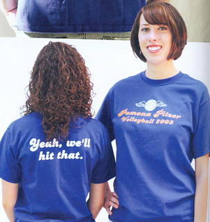 Students modeling the 2005 women's volleyball team t-shirts