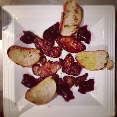 Seared foie gras with gelee de cassis and grilled baguette.