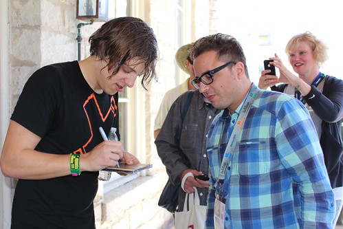 Robert DeLong signs CDs for the fans