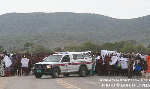 Police car blocking the protest march of Himba and Zemba in Namibia, but the protesters continue their peaceful walk towards Opuwo, where they will meet the governor of Kunene
