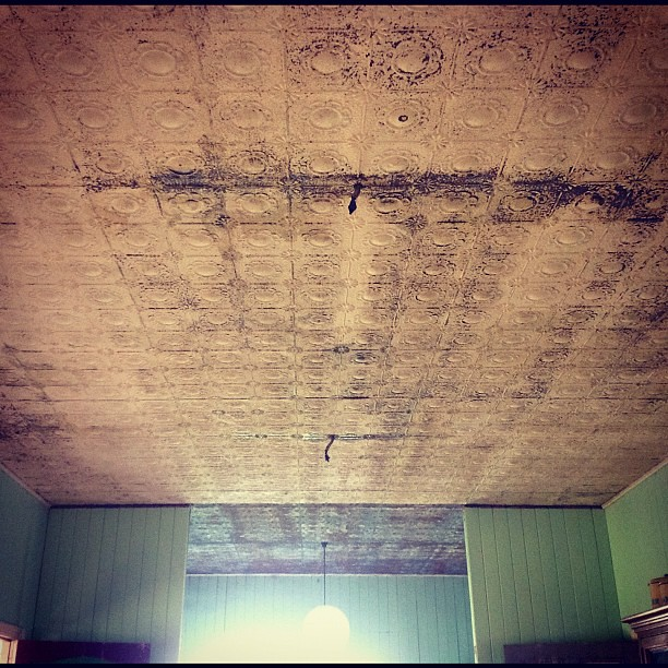 There's a lot of restoration work to do in here. #pressedmetalceilings