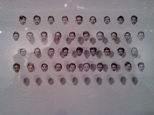 Il muro delle facce ritagliate by Ylbert Durishti