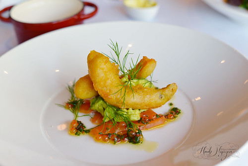 Citrus cured salmon rose, spiced avocado & prawn beignet