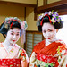 Portrait of two Maiko girls in Japanese tatami room by Apricot Cafe