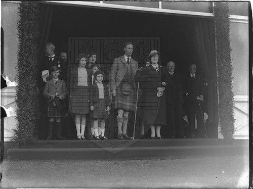 1958 Braemar Gathering. King George VI and Queen Elizabeth and the Princesses Elizabeth and Margaret standing in pavilion doorway