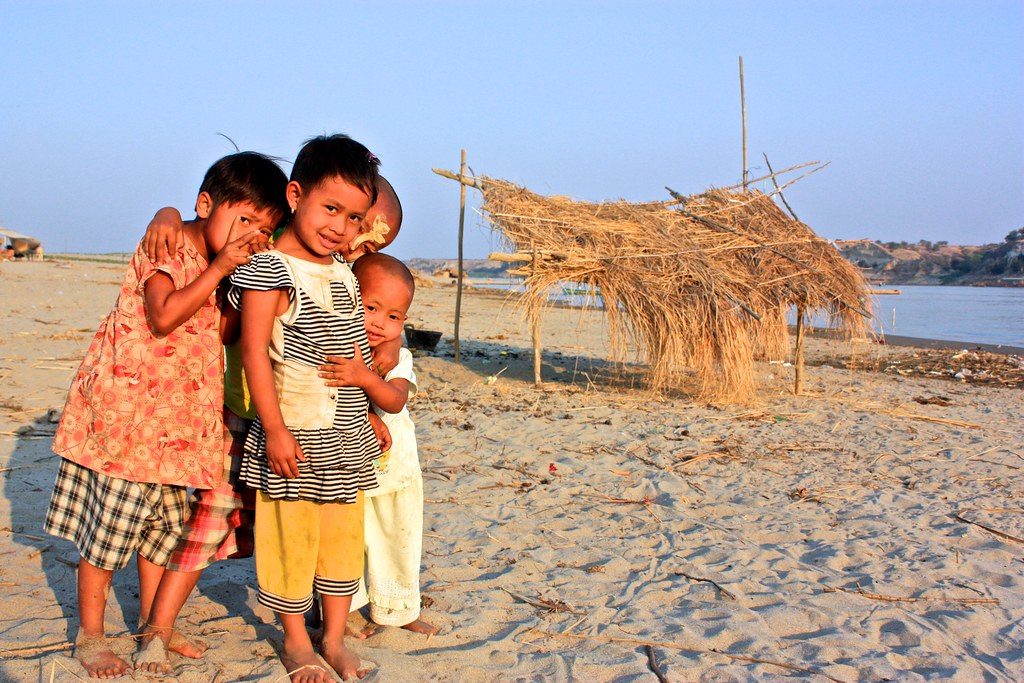 kids living in a fishing village on a sand bar in the river