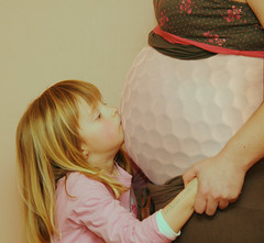 Pregnant Golf Ball Kiss