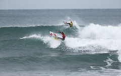 Italy's Leonardo Fioravanti (red) and Jackson Baker (yellow) trade blows.