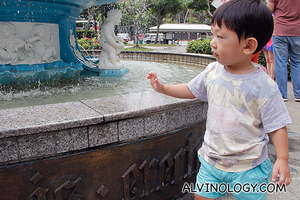 Asher walking round and round the fountain