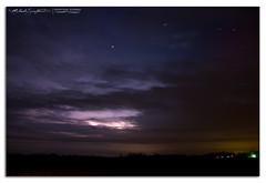 Distant cumulonimbus with lightning and stars - 04162013