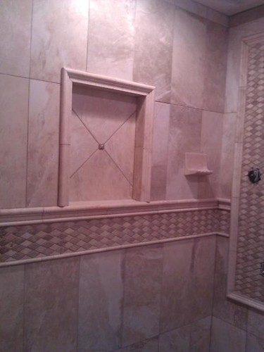 Porcelain and travertine tile designs