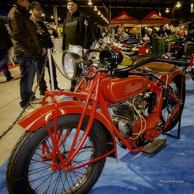 "On of the fascination exhibitors at the Timonium Motorcycle Show this weekend, was the venerable ""Mike Pelton"" ( on right behind bike), who brought his ""Hawg Wiild"" collection of classic and vintage motorcycles. As I've always been a fan of the 'Indian"" brand I had to capture this fine example of a vintage 1924 Standard ""Scout"".    NIK ""Color Efex Pro 4""    © 2013 Doug Miller Photography  <a href=""http://www.dougmillerphotos.com"" rel=""nofollow"">www.dougmillerphotos.com</a>  <a href=""http://www.speedovision.com"" rel=""nofollow"">www.speedovision.com</a>"