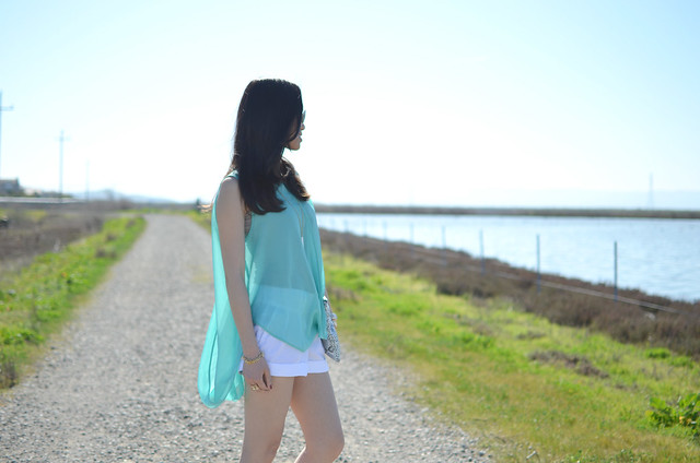 summer outfit: aqua flowing high-low top & white shorts