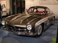 supercar(0.0), race car(1.0), automobile(1.0), automotive exterior(1.0), vehicle(1.0), automotive design(1.0), mercedes-benz(1.0), auto show(1.0), mercedes-benz 190sl(1.0), mercedes-benz 300sl(1.0), antique car(1.0), classic car(1.0), land vehicle(1.0), luxury vehicle(1.0), sports car(1.0),