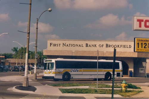 A westbound Pace Rt # 304 /  La Grange  bus entering the Eight Corner's traffic circle via Washington Street.  Brookfield Illinois.  May 1989. by Eddie from Chicago