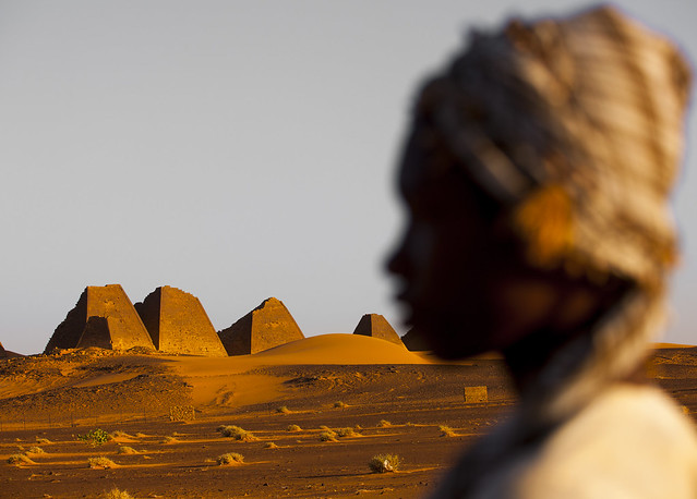 Kid In Front Of The Pyramids And Tombs In Royal Cemetery, Meroe, Sudan