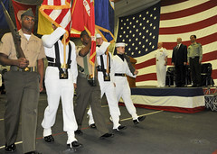Sailors and Marines parade the colors during a reception aboard USS Peleliu (LHA 5) in Hong Kong April 15. (U.S. Navy photo by Mass Communication Specialist 3rd Class Dustin Knight)